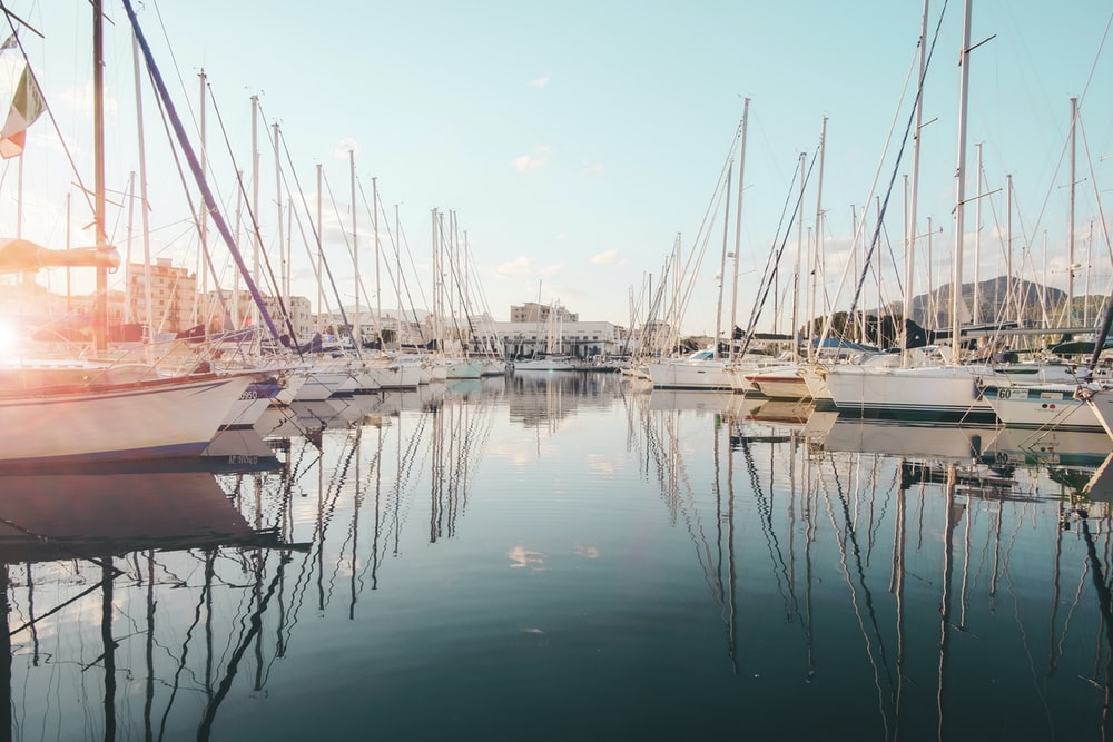 white sailboat in body of water during daytime