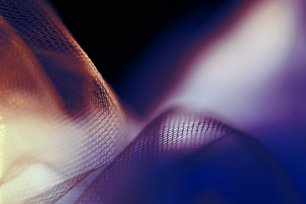 selective focus photography of mesh textile