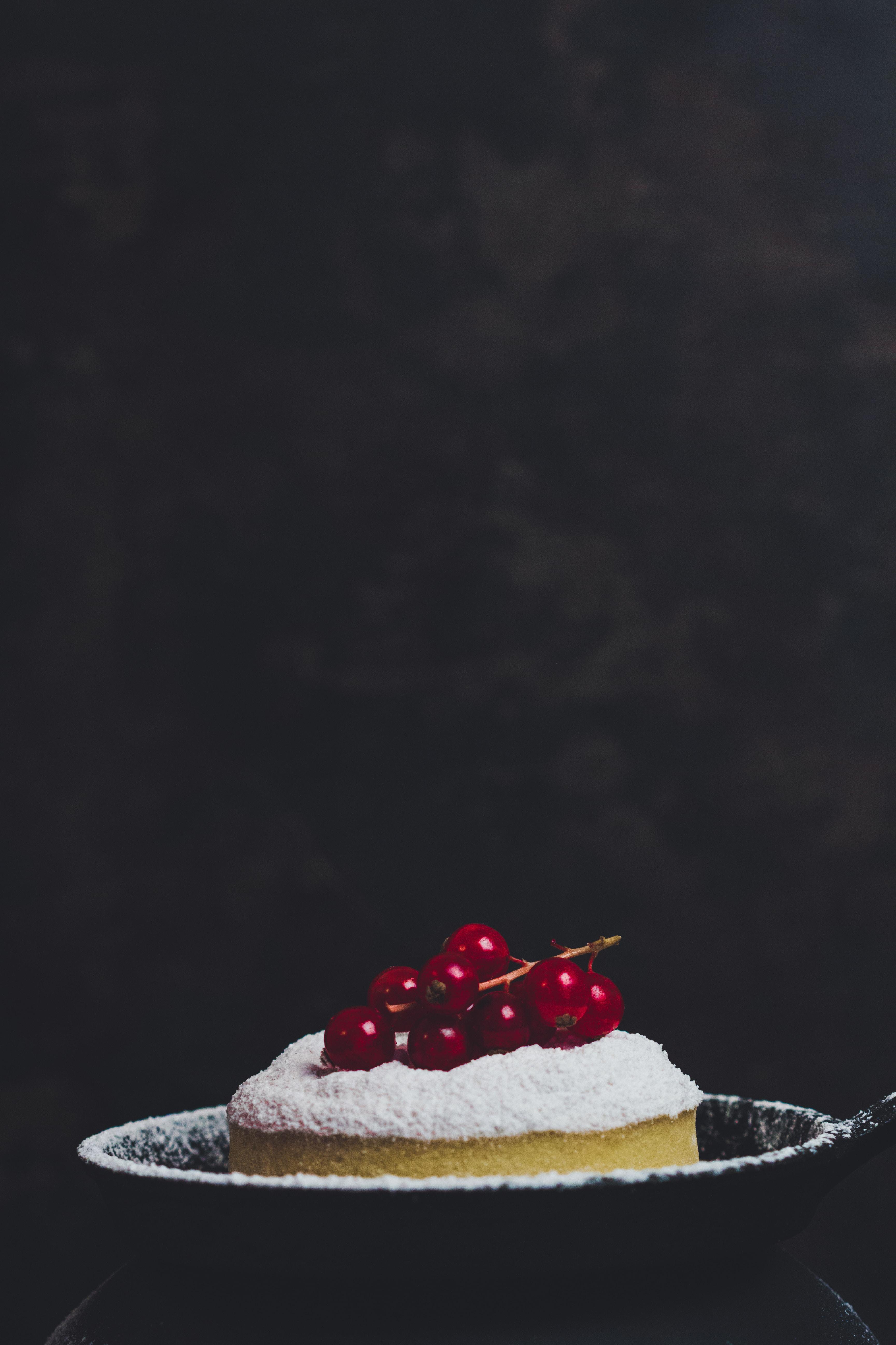 one slice of cake in black bowl