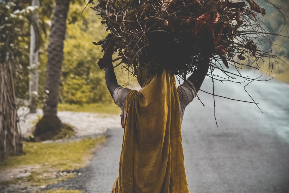 person carrying hay