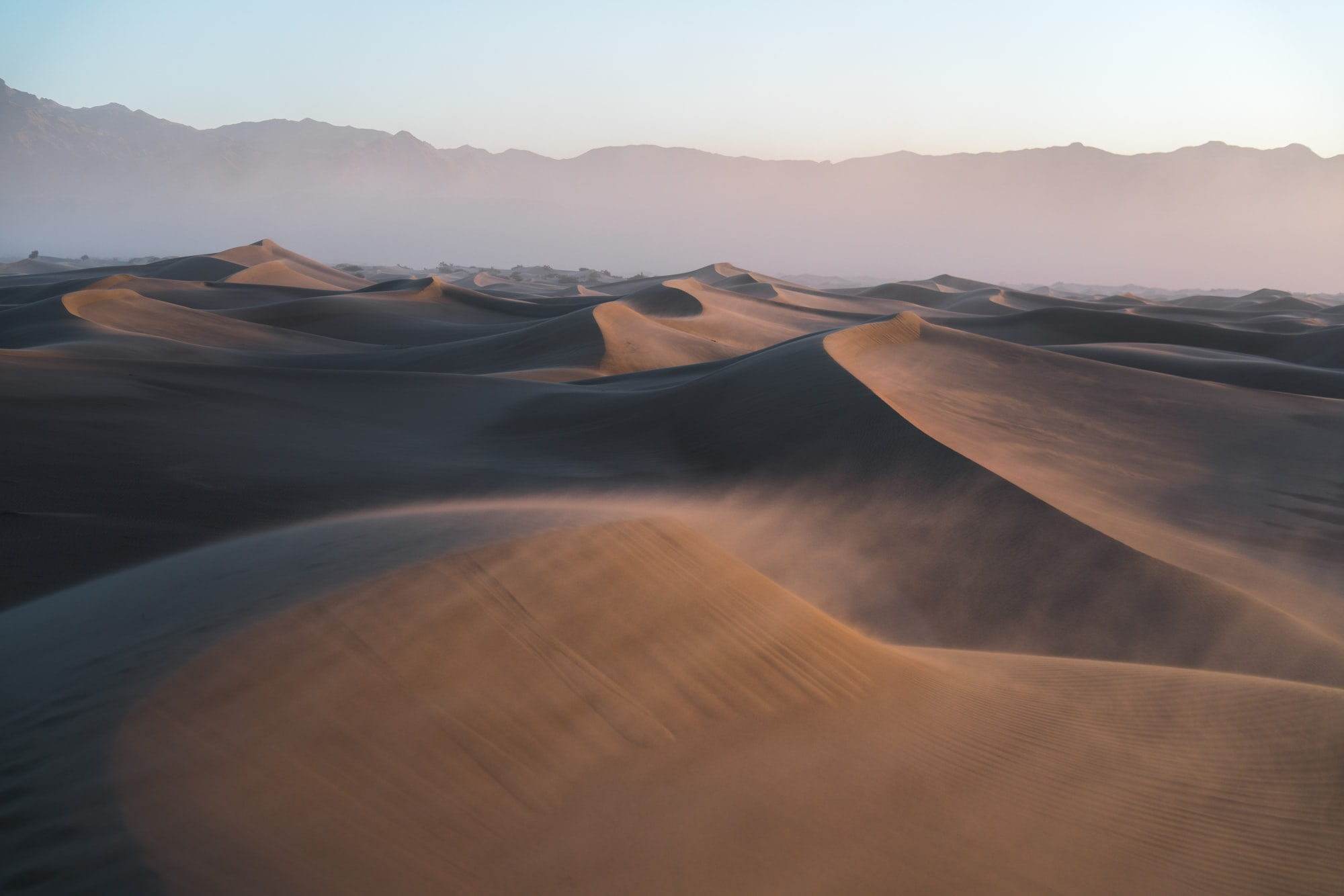 I found myself trekking through the dunes in the middle of 33MPH winds. It was early in the morning when the winds were less violent, but when the sunrise hit the winds took a drastic change for the worse.