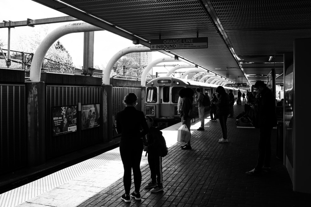 people waiting for the train to stop at the station