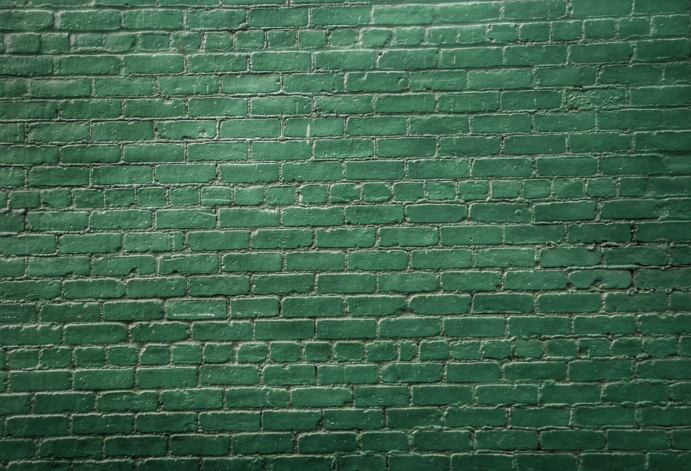 A green painted wall which signifies why I write - to learn to see above and beyond the wall of individual perspective