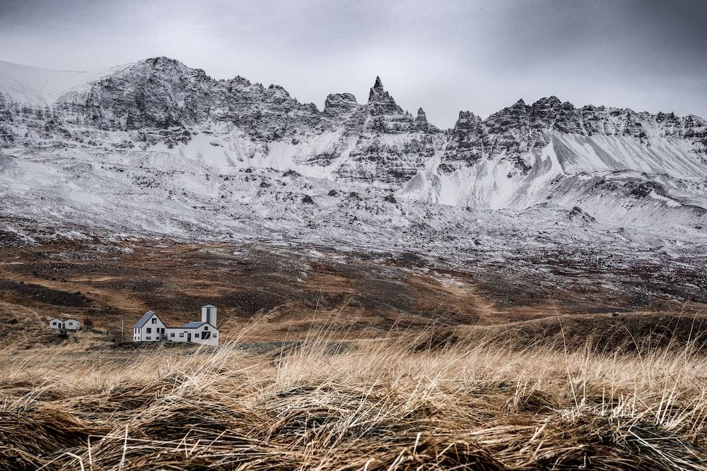 white concrete house near mountains