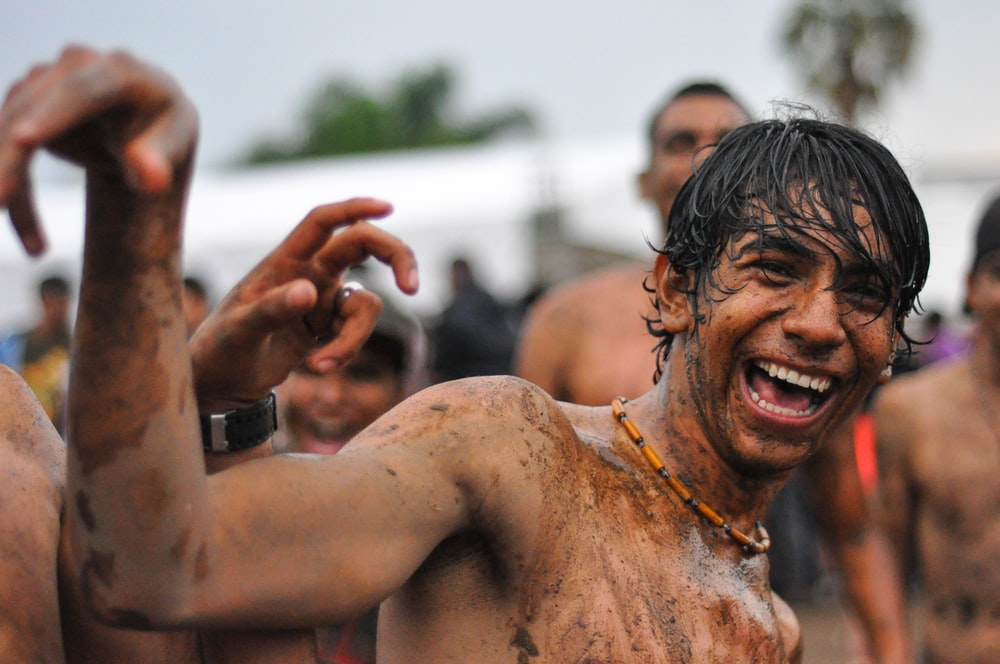 people playing mud outdoor