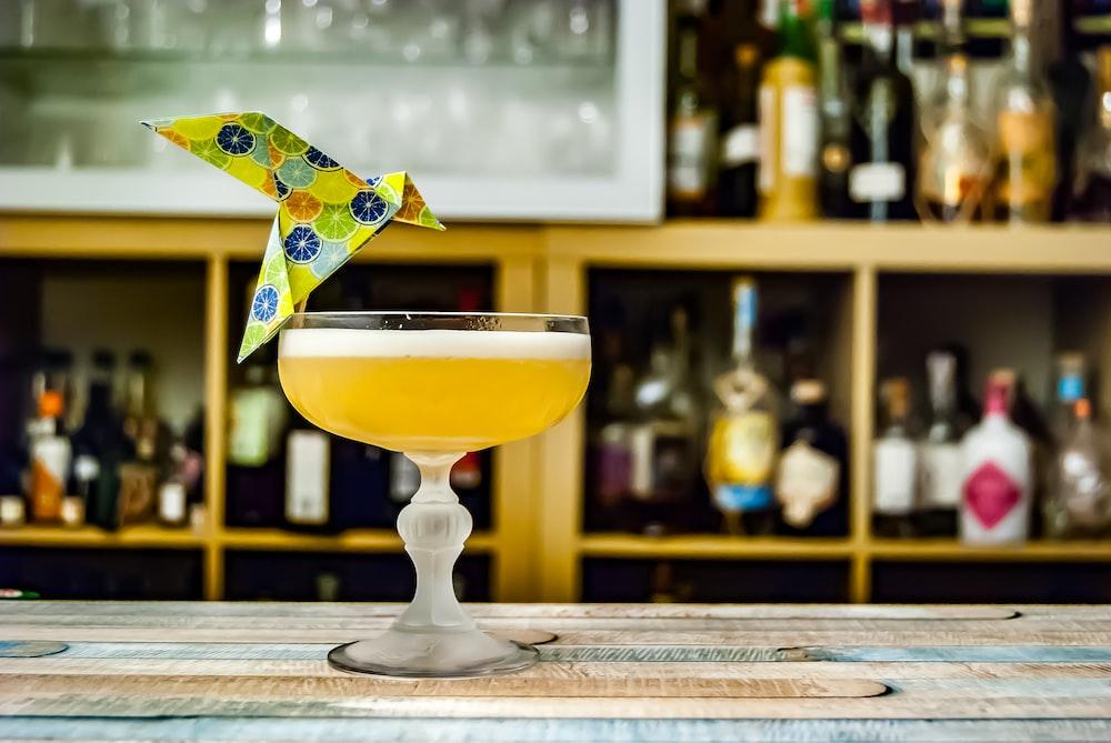 margarita glass with yellow liquid