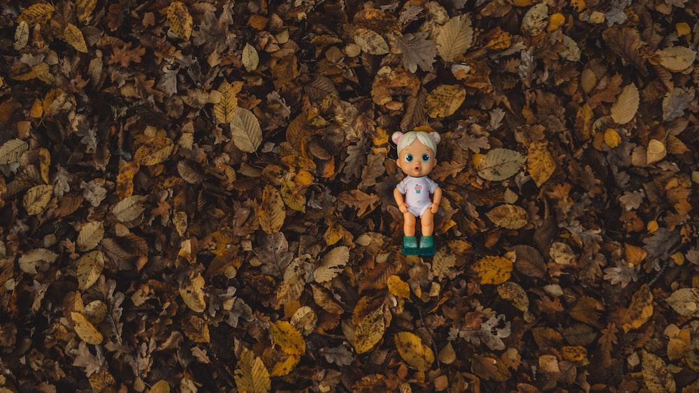 girl doll on ground
