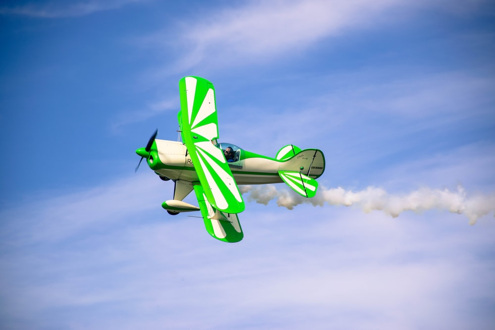 green and white airplane