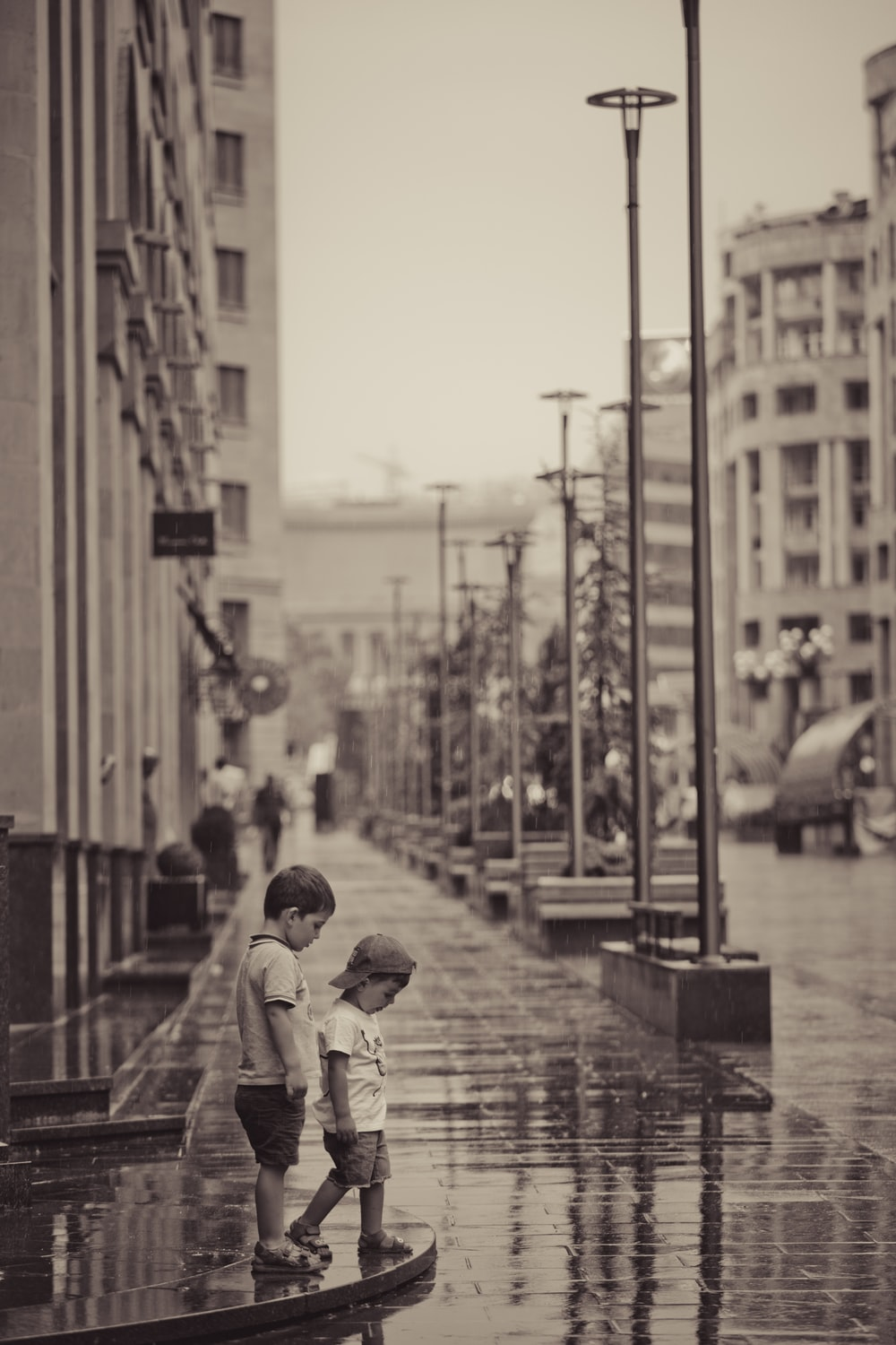 two children standing on streets