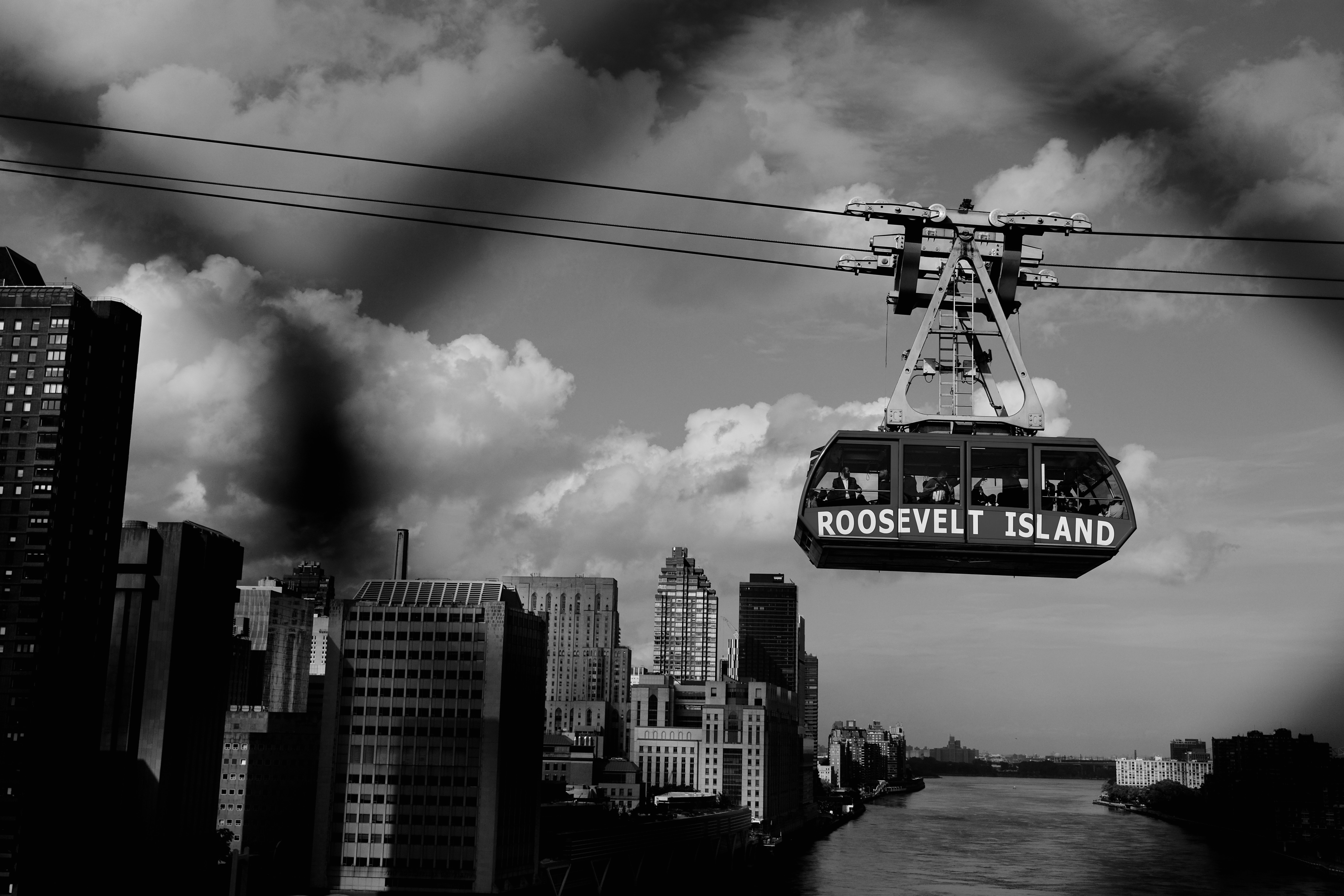 Roosevelt Island cable car on cable greyscale photography during daytime