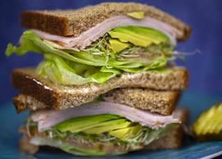 sandwich with ham and green vegetables