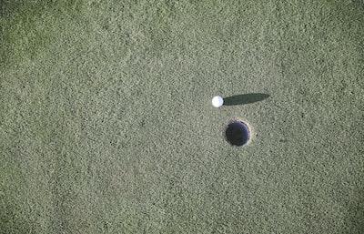 white golf ball near hole