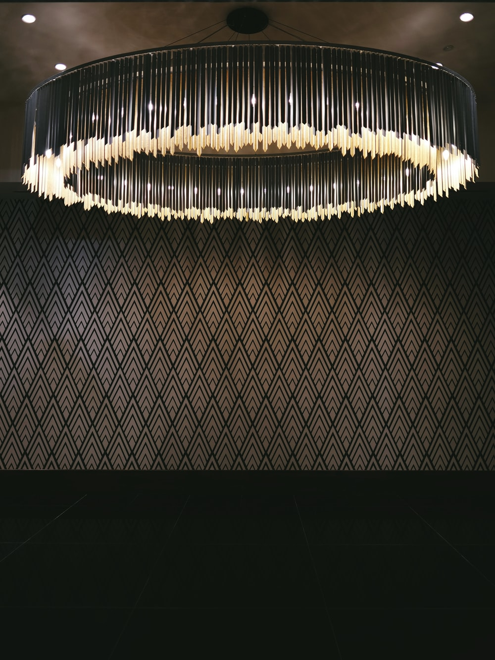 turned-on gray chandelier