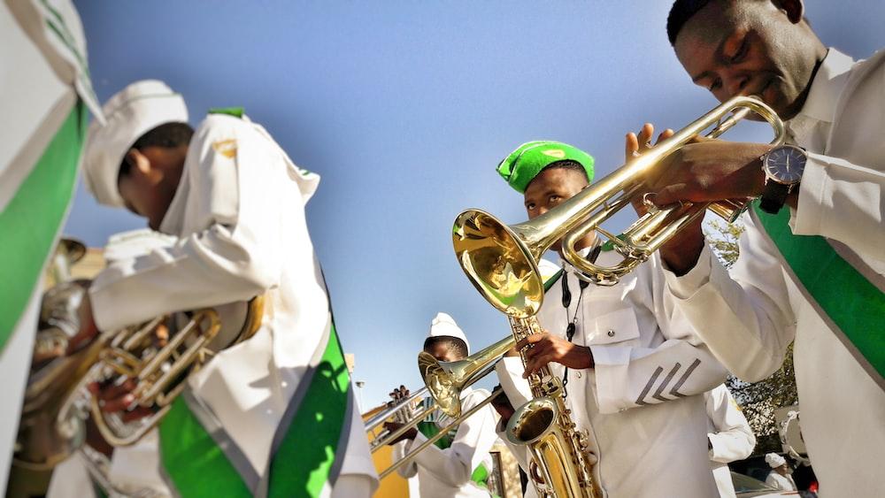 men playing musical instrument during daytime