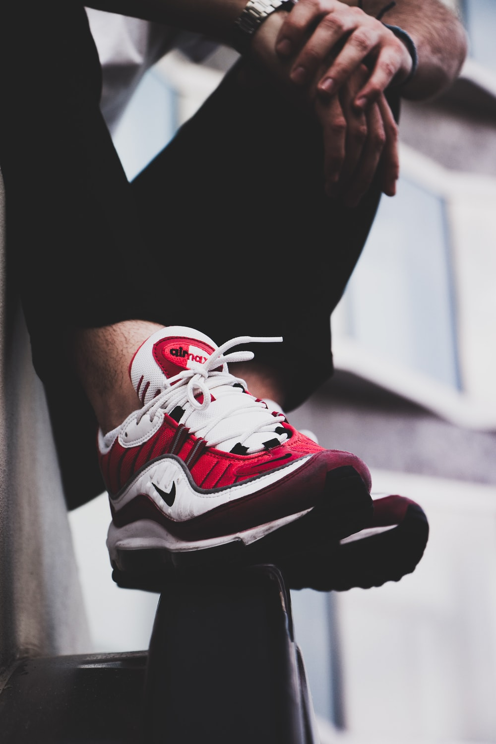 red-and-white Nike Air Max shoes\