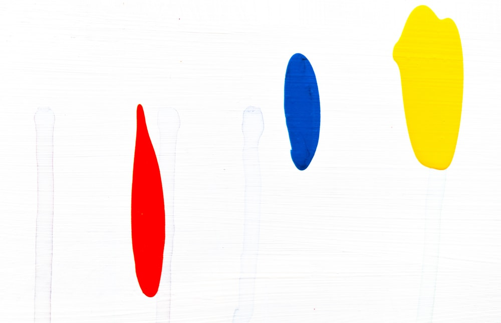 red, blue, and yellow paints graphic