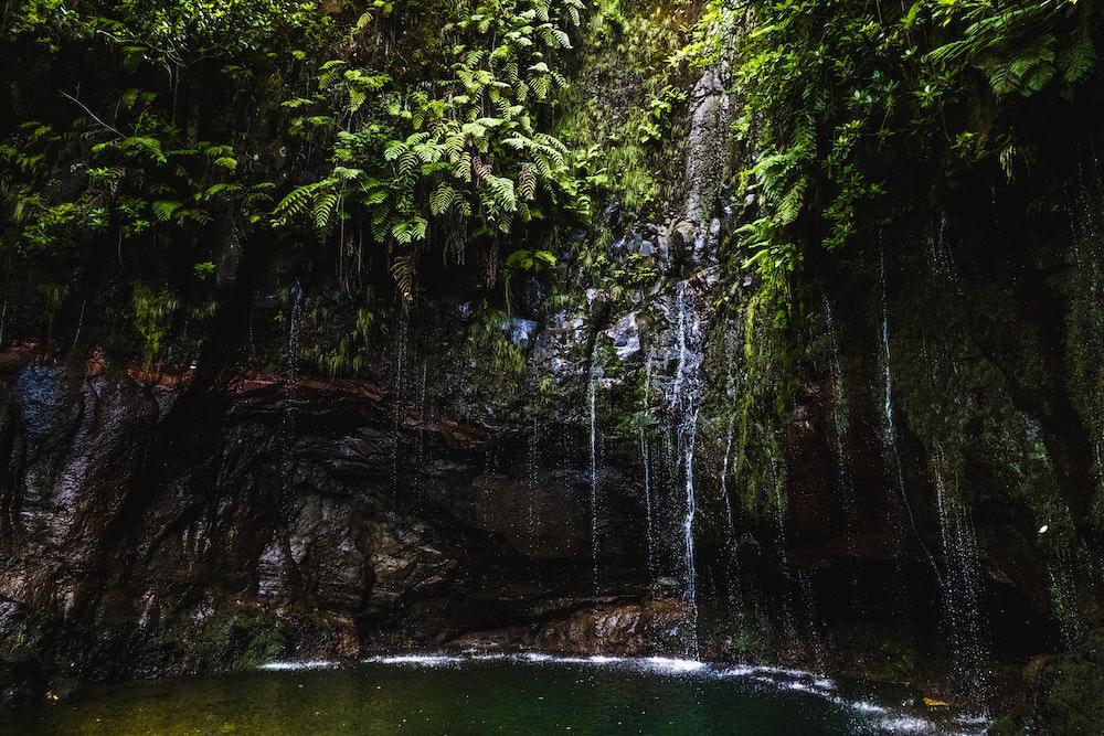 waterfalls cascading into lagoon