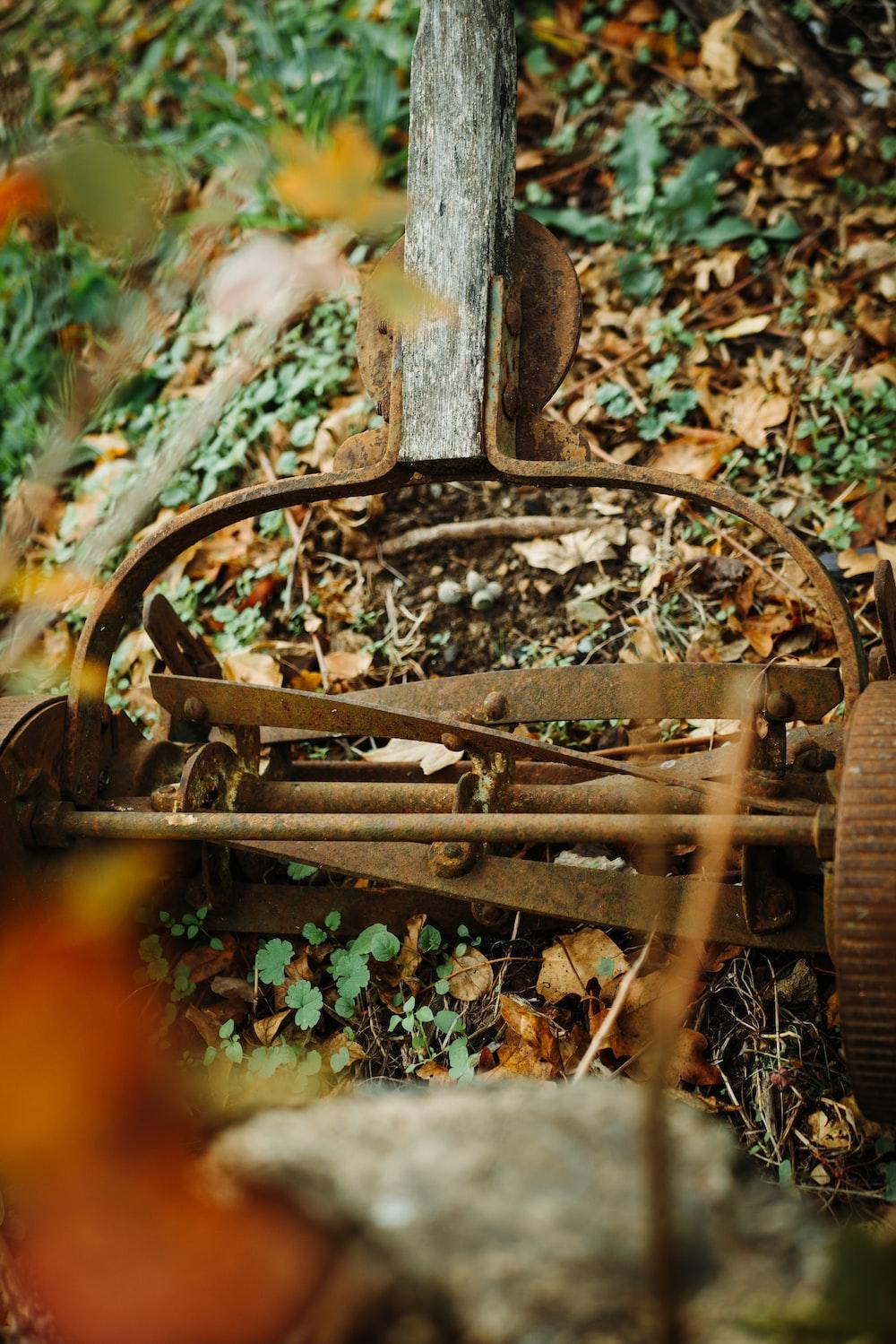 brown reel mower on ground