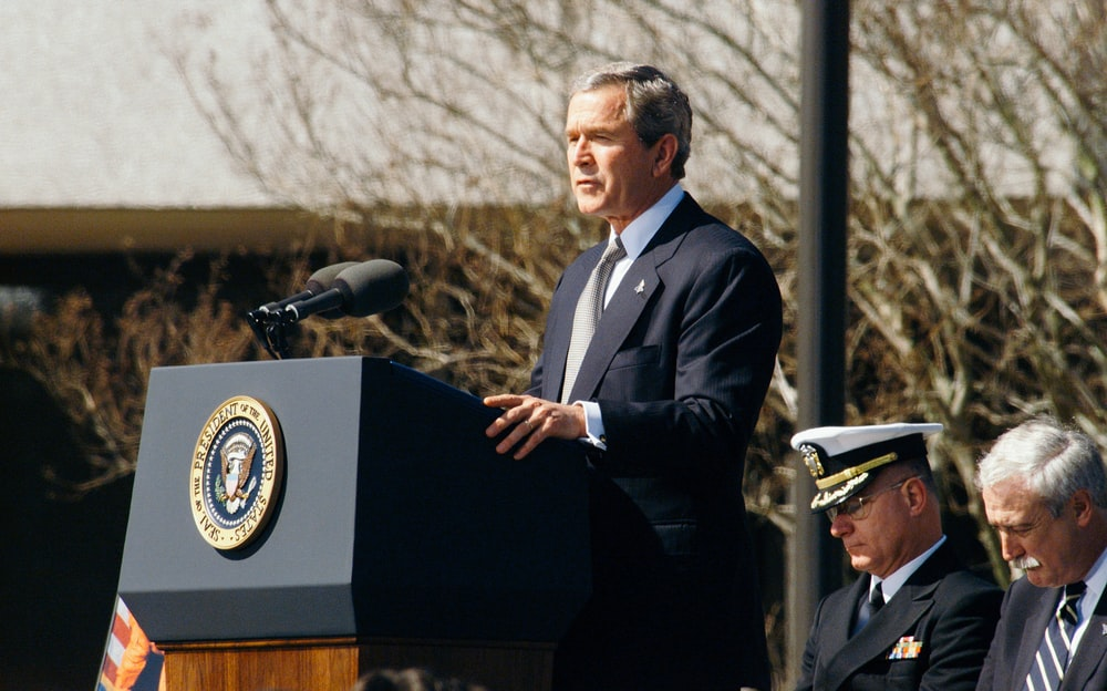 George W. Bush standing on lectern during daytime