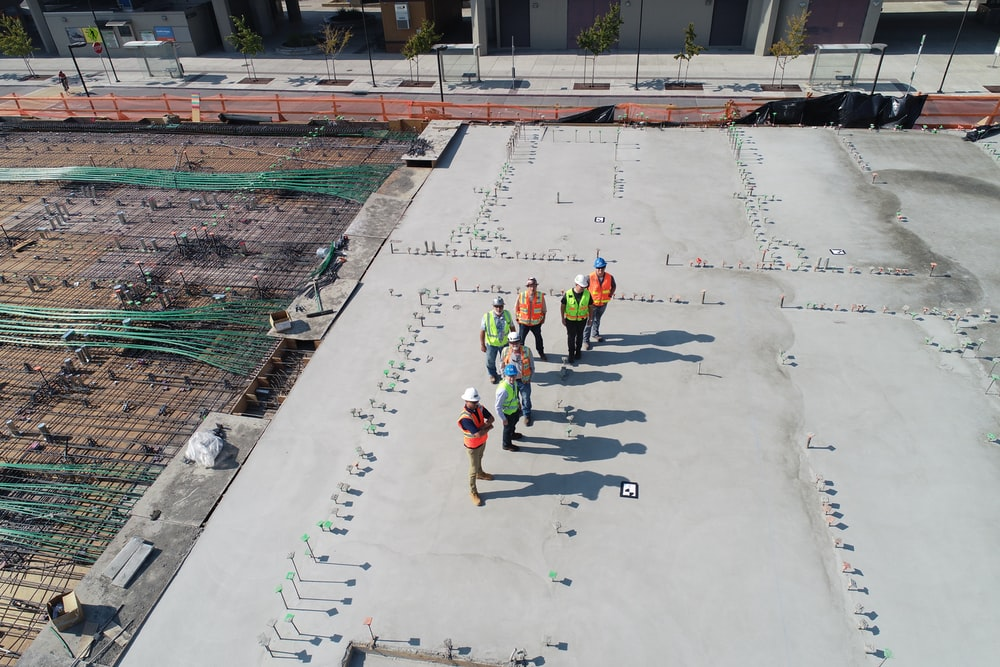 seven people standing on rooftop