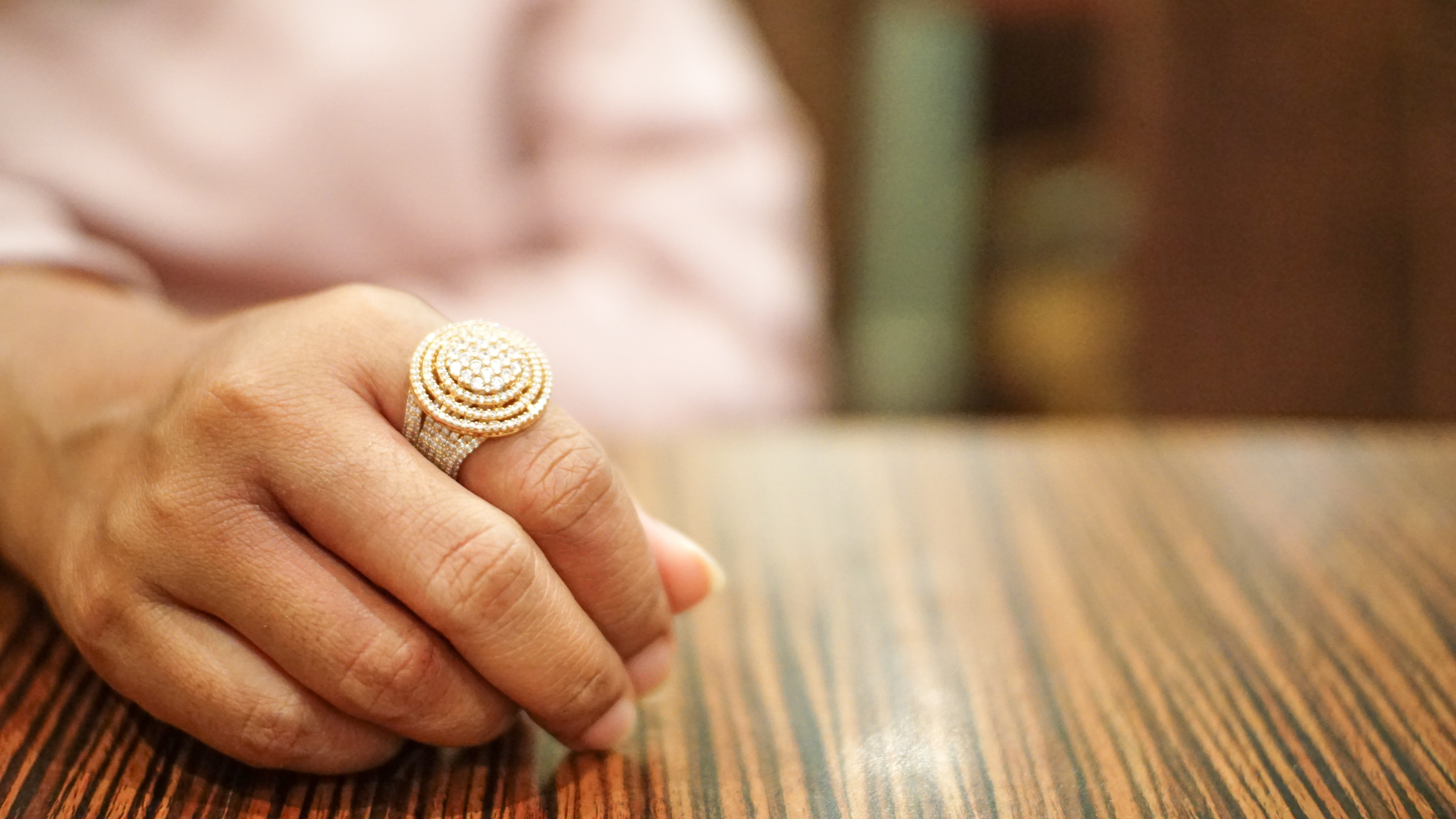 person wearing gold-colored ring