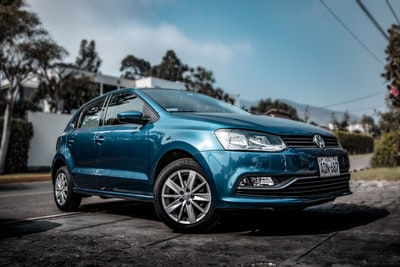 blue volkswagen polo 5-door hatchback volkswagen zoom background