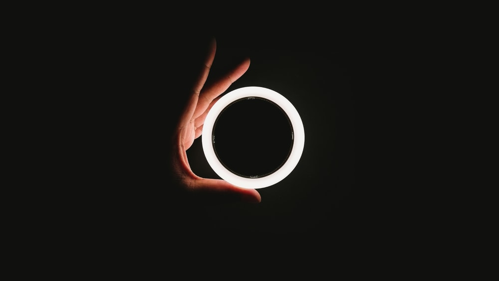 person holding white ring light