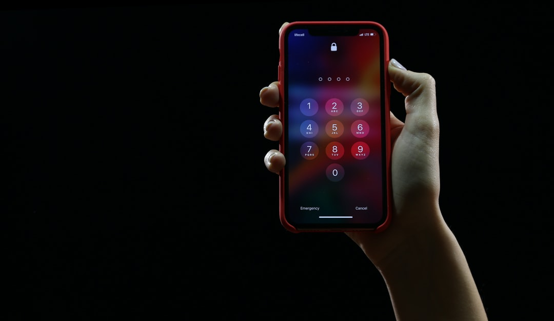 Hand with locked iPhone X