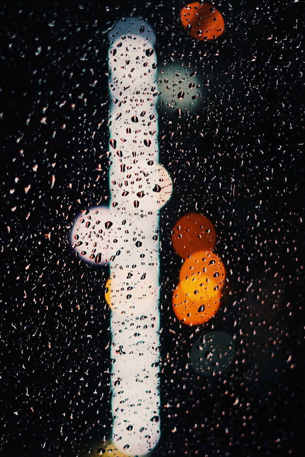 bokeh photography of water droplets
