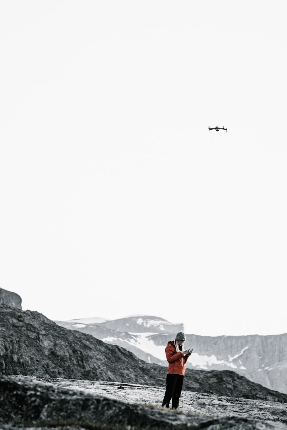 person standing in mountain under plane during daytime