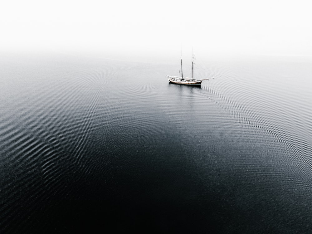 ship on water during cloudless sky