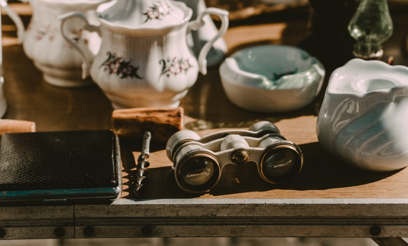 gray binocular beside white ceramic oil diffuser
