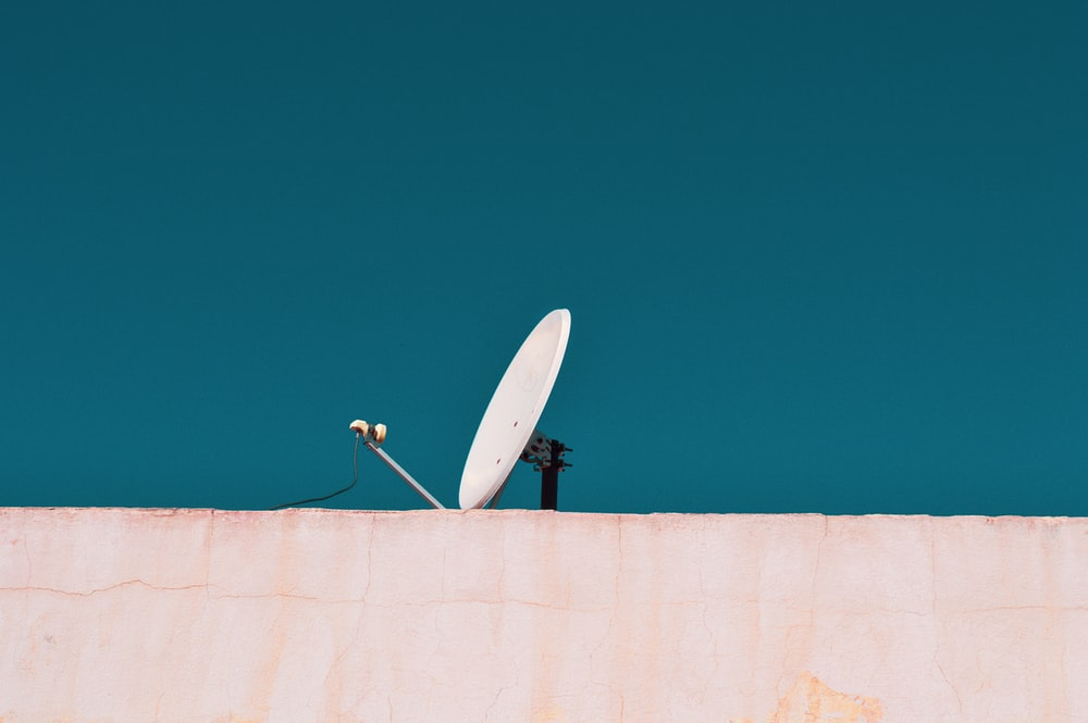 white parabolic antenna