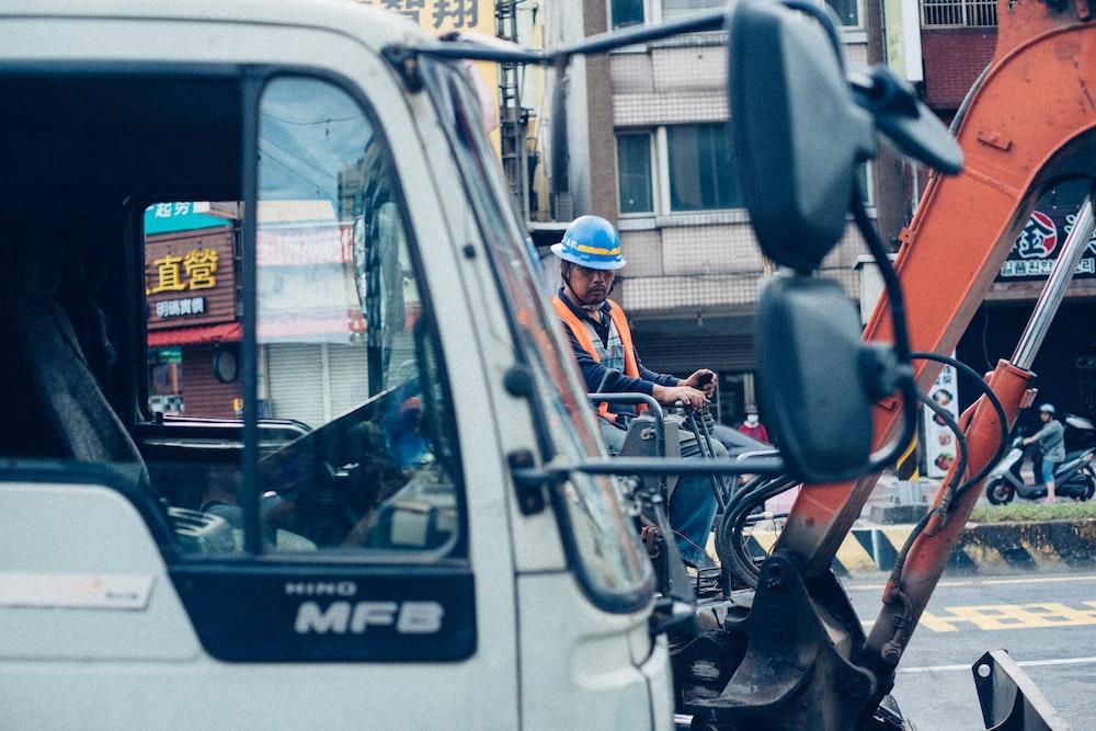 person riding excavator