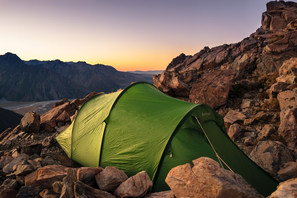 green tent on mountain