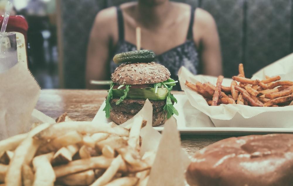 burger beside potato fries