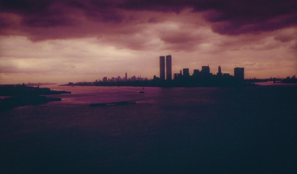 silhouette of buildings under dark sky