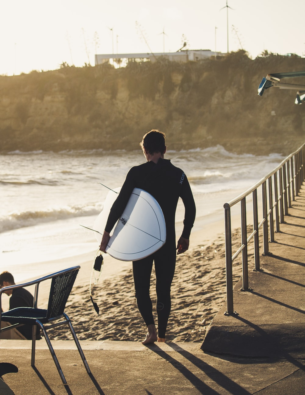 man carrying surfboard during daytime