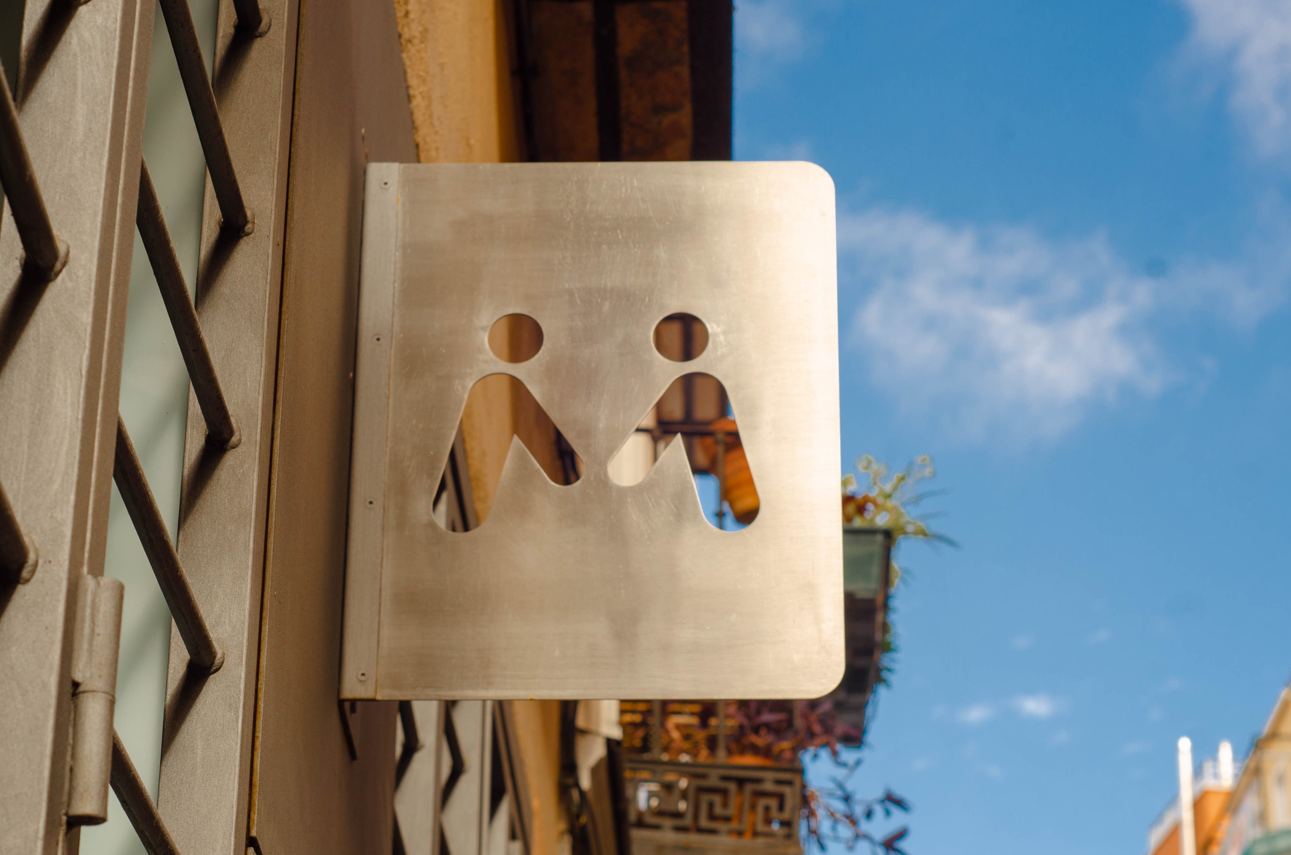 two person holding hands signage during daytime