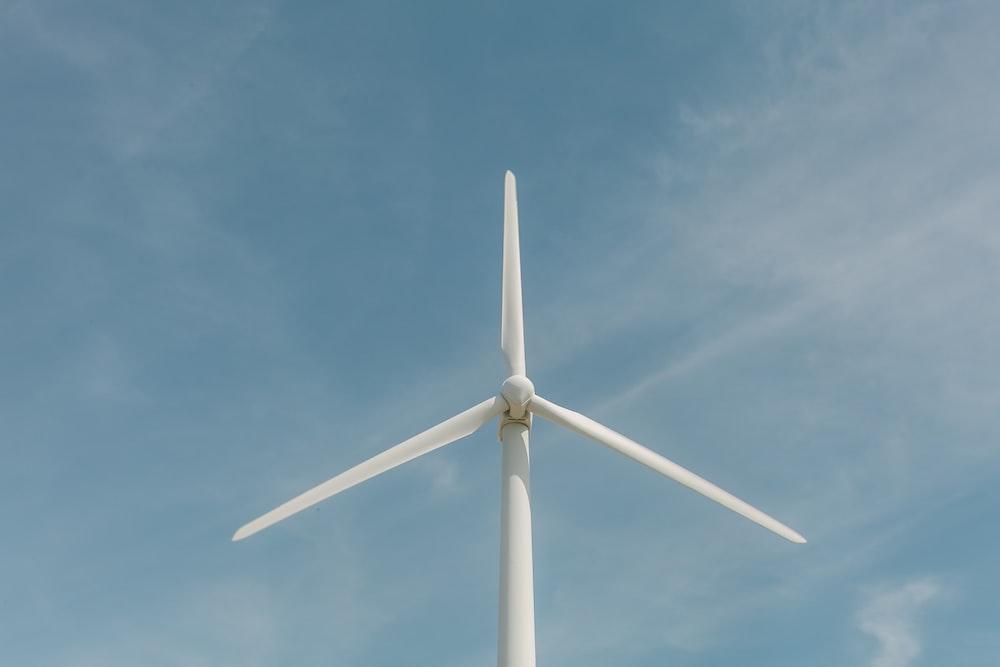 white windmill under calm blue sky