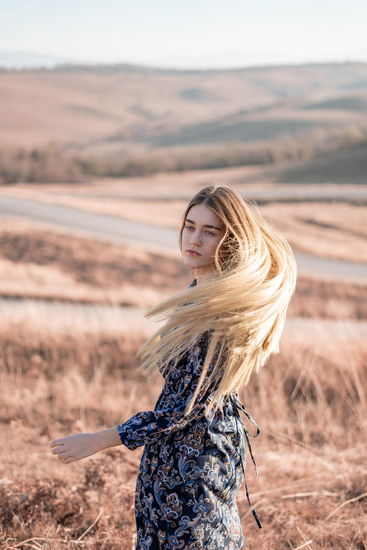 woman standing in brown field