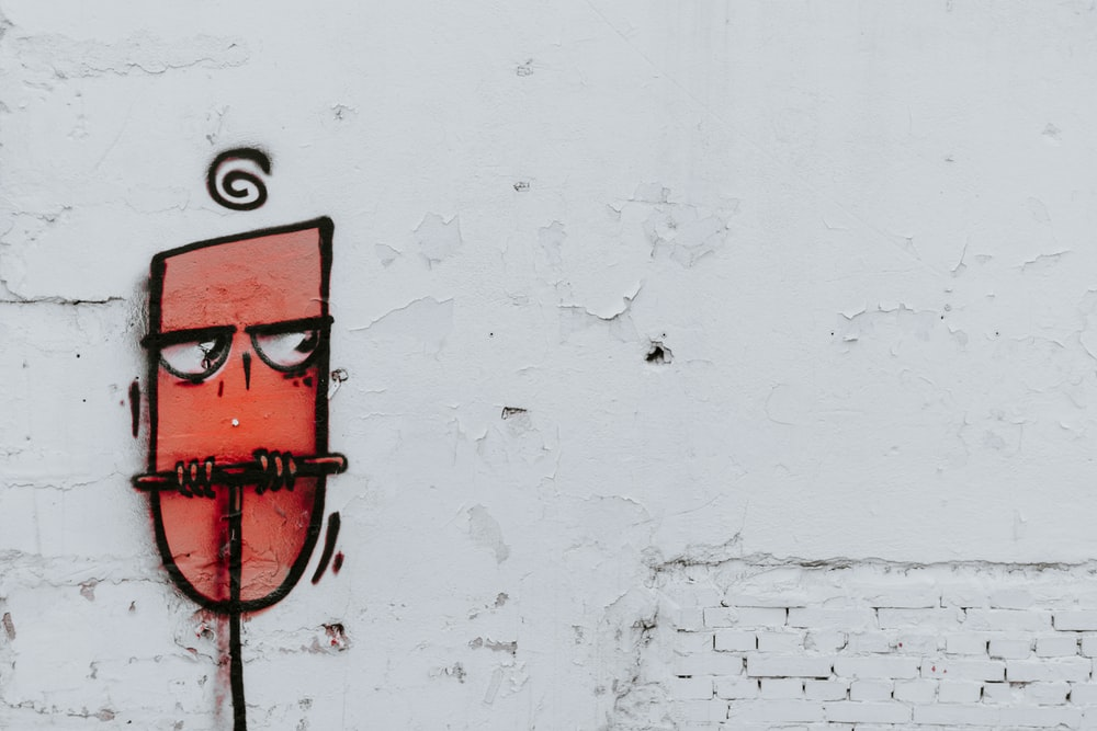 human tongue painted white wall