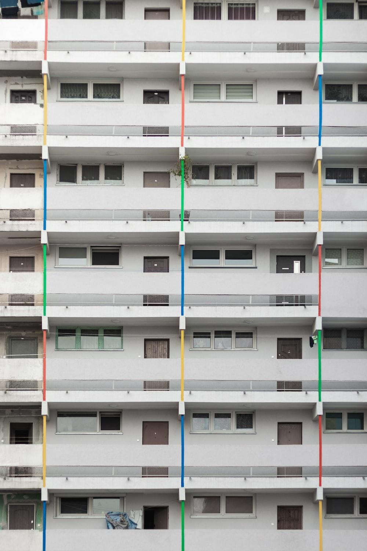 white concrete multi-storey building