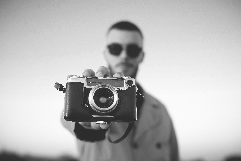 man standing and showing bridge camera