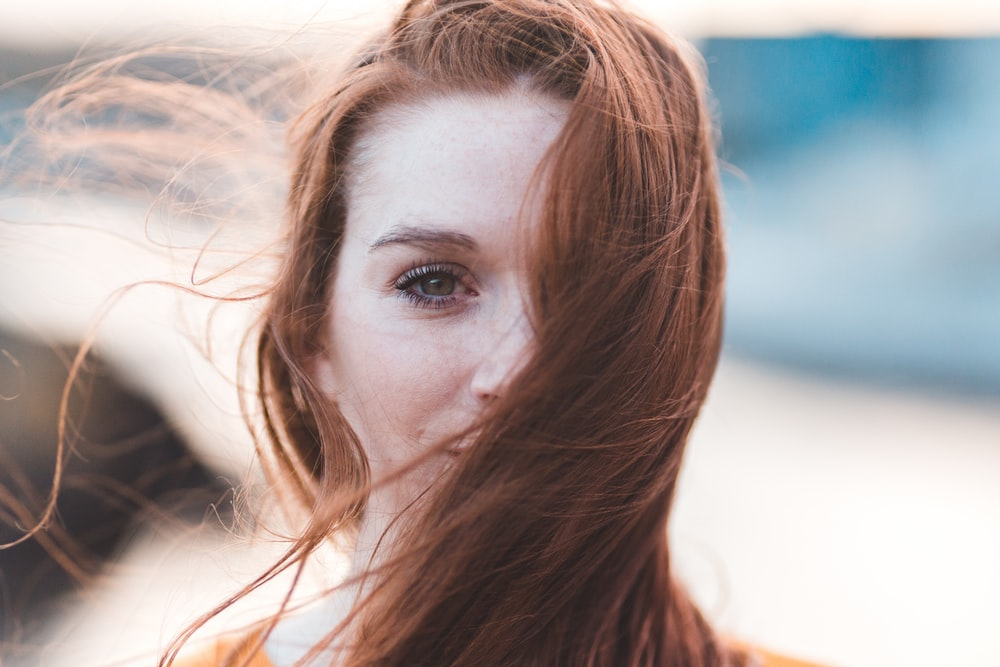 woman's face covered with hair