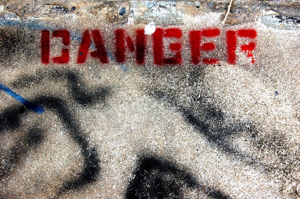 concrete ground with red danger text print