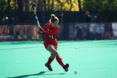 woman playing hockey on fields during daytime team sport zoom background