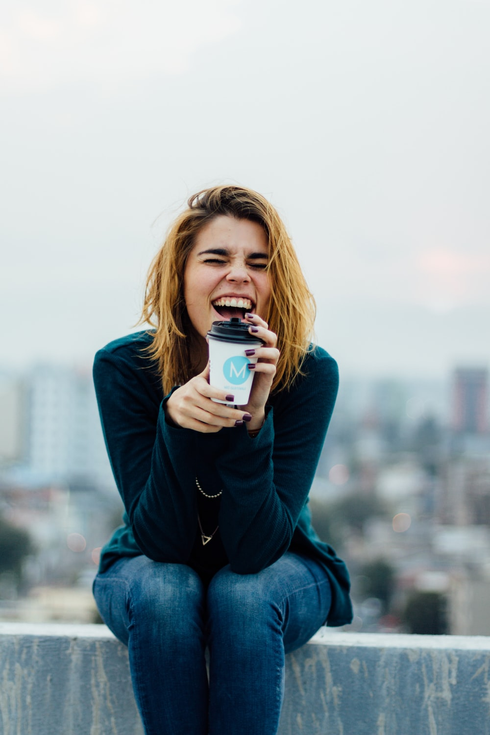 smiling woman holding cup