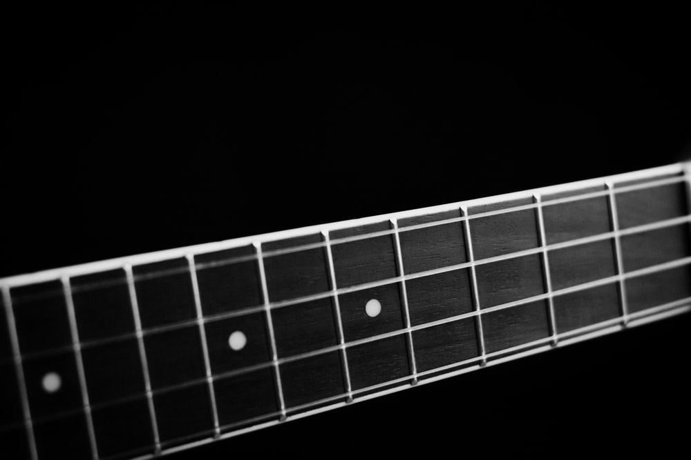grayscale photography of guitar neck