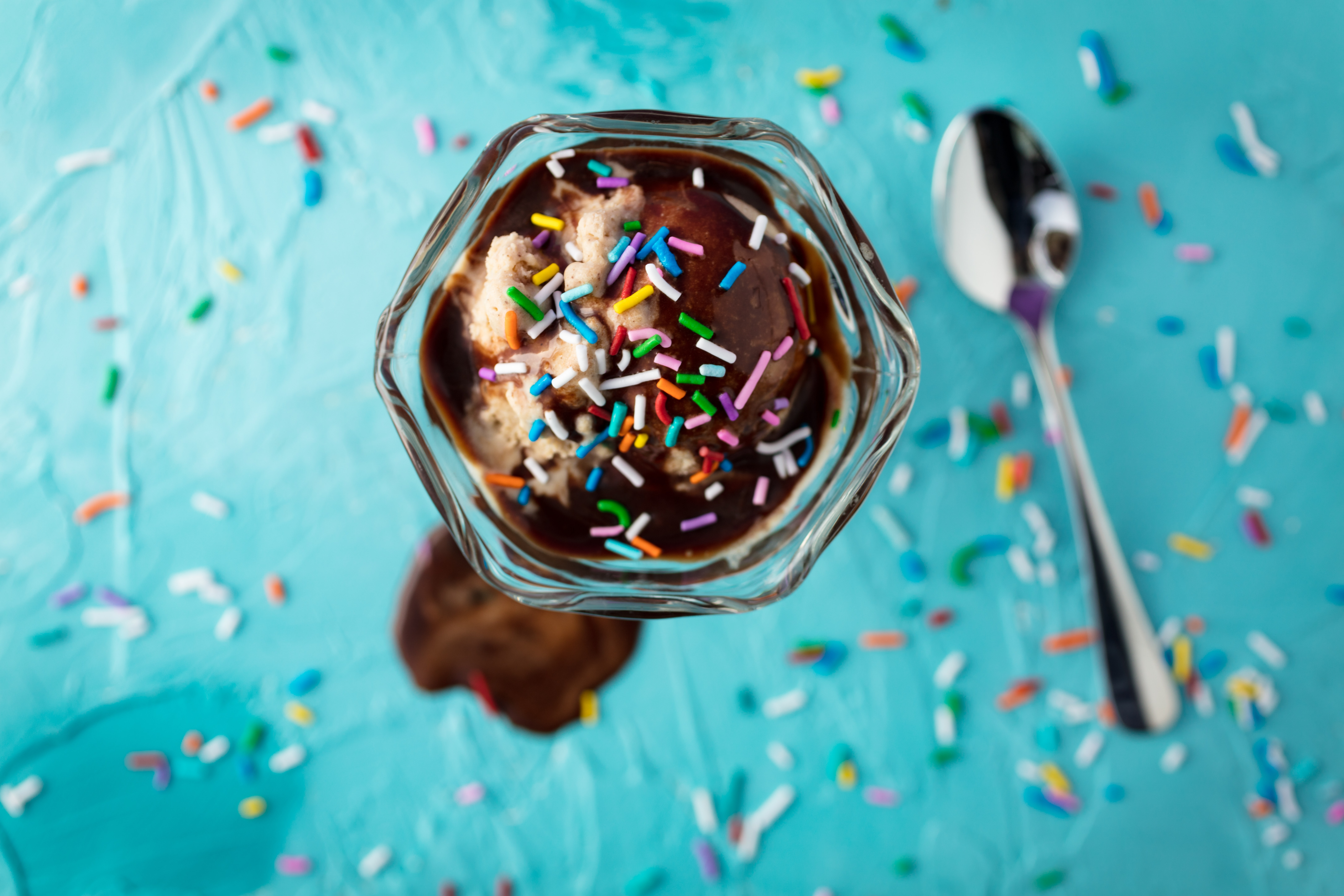 ice cream in glass beside spoon